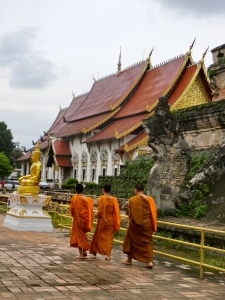 Monks strolling around Wat Chedi Luang
